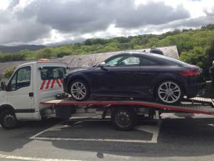 picture of a car transporter in chester, wirral and liverpool with a car on